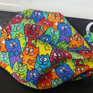 Colorful Cats Face Mask - A face mask with colorful cats on it. #Cats