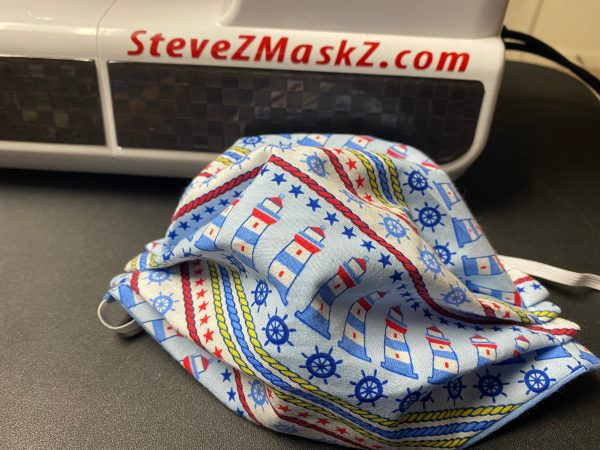 Slanted Nautical Face Mask - A Cute nautical-themed face mask with Lighthouses, Ship Wheels, Rope and stars on it. #Nautical