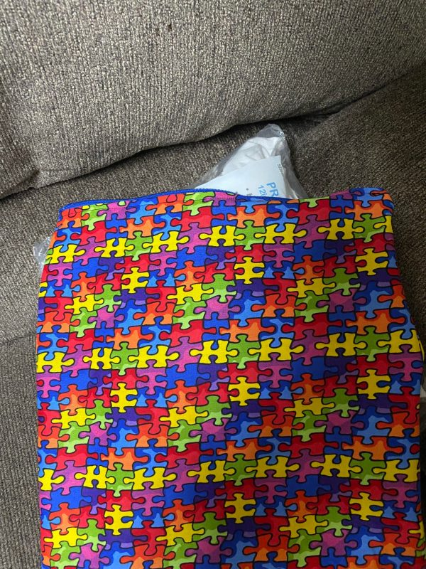 Autism Awareness Decorative Pillow - A decorative pillow with colorful puzzle pieces on it. #Autism #AutismPillow #AutismAwareness