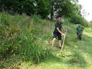 scything on a slope or bank