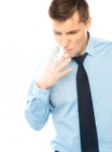 man in tie smoking