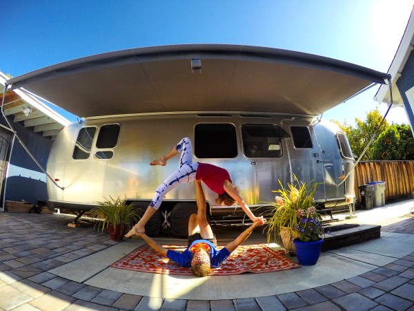Photo of acro yoga in front of an Airstream Camper in San Jose, California