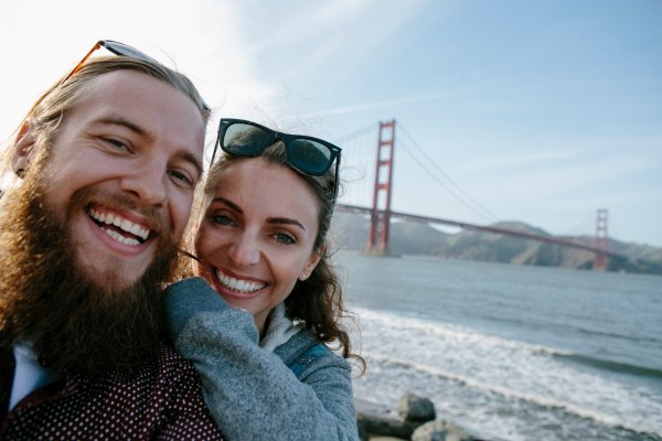 Selfie of a couple in front of the Golden Gate Bridge San Francisco California