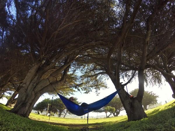 Photo of me sleeping in an Eno Hammock in Half Moon Bay, California
