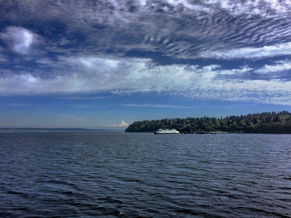 photo in the puget sound with mount rainier in the background