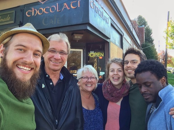 selfie of a family in front of chocolati cafe in seattle, washington