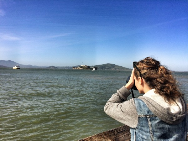 A photo of a photographer taking a photo of Alcatraz Island