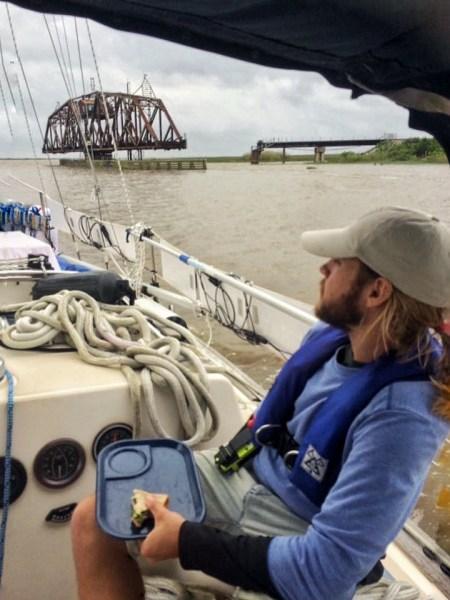 Photo of sailor crossing the Rigolets Railroad into Lake Borgne, Louisiana