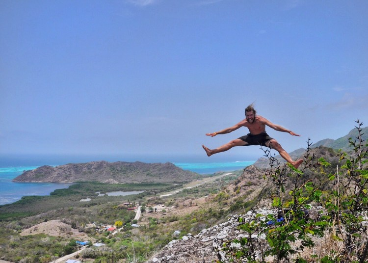 Photo of stevie vagabond jumping on top of Split Hill in Providencia