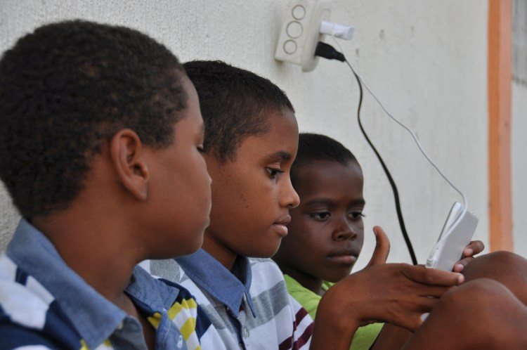 Photo of local colombian boys on a tablet in Providencia