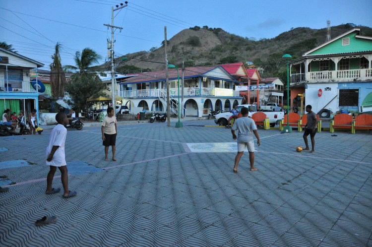 Photo of local colombian boys playing soccer in Providencia