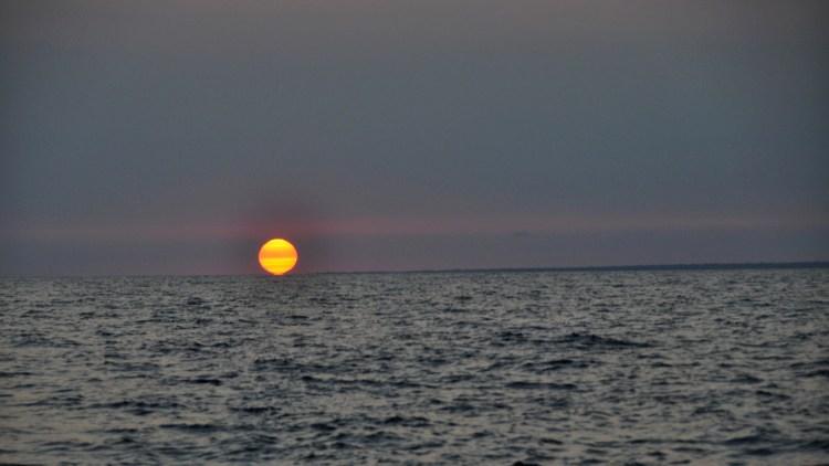 photo of the sun set at cabo san antonio, cuba