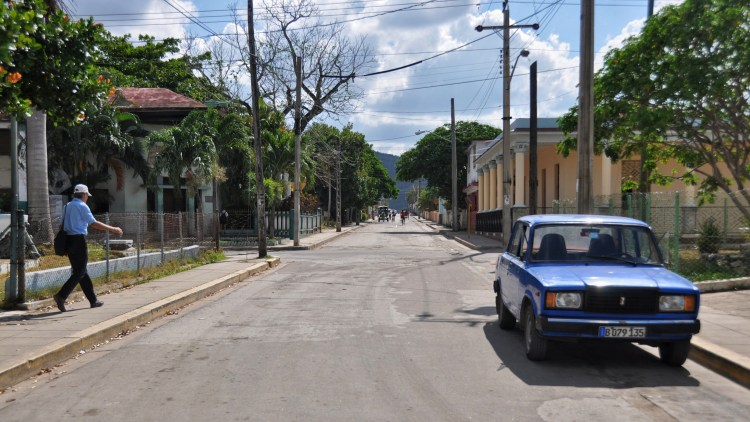 Photo of a street and old car in Nueva Gerona, Cuba by Stevie Vagabond