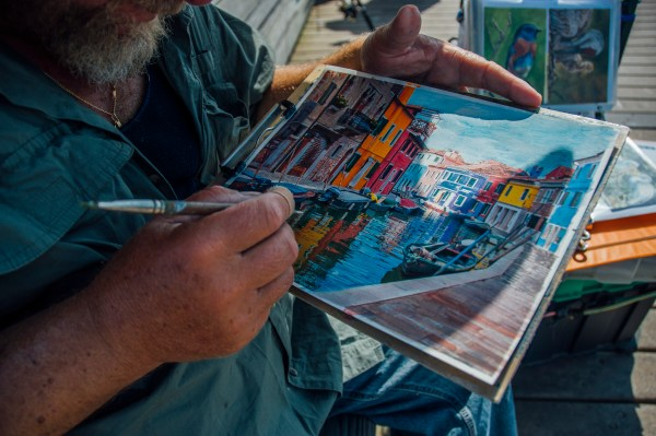 Photo of an artist painting in Venice florida