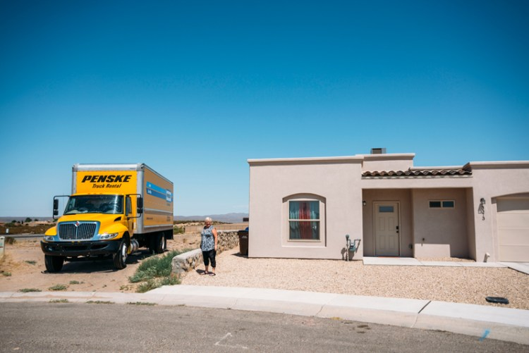 Photo of a lady and a Penske truck outside of her AirBnb in Las Cruces, New Mexico.