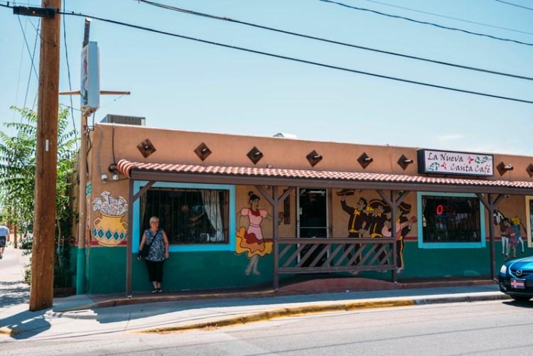Lady standing outside of La Nueva Casita Café in Las Cruces