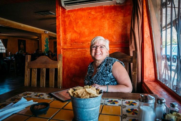 Photo of a lady smiling inside La Nueva Casita Cafe in Las Cruces.