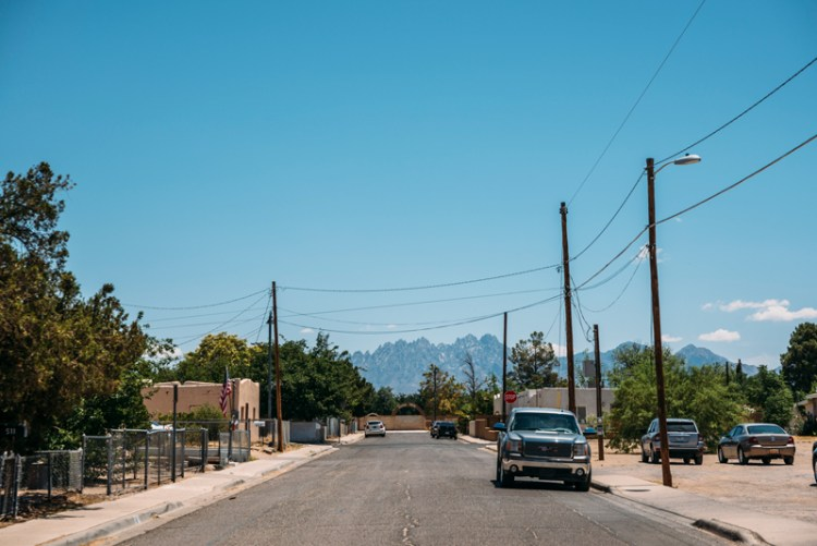 Photo of a street in downtown Las Cruces with the Organ Mountains in the background.