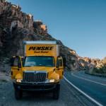 Photo of a Penske truck on the roadside in Arizona.
