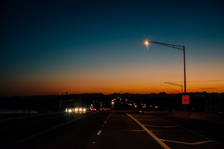 Photo of an Arizona highway at night time.