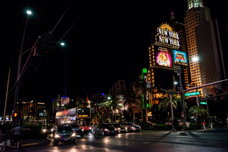 photo of an intersection on the las vegas strip at night
