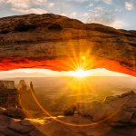 Photo by Stevie Vagabond of Mesa Arch at sunrise.