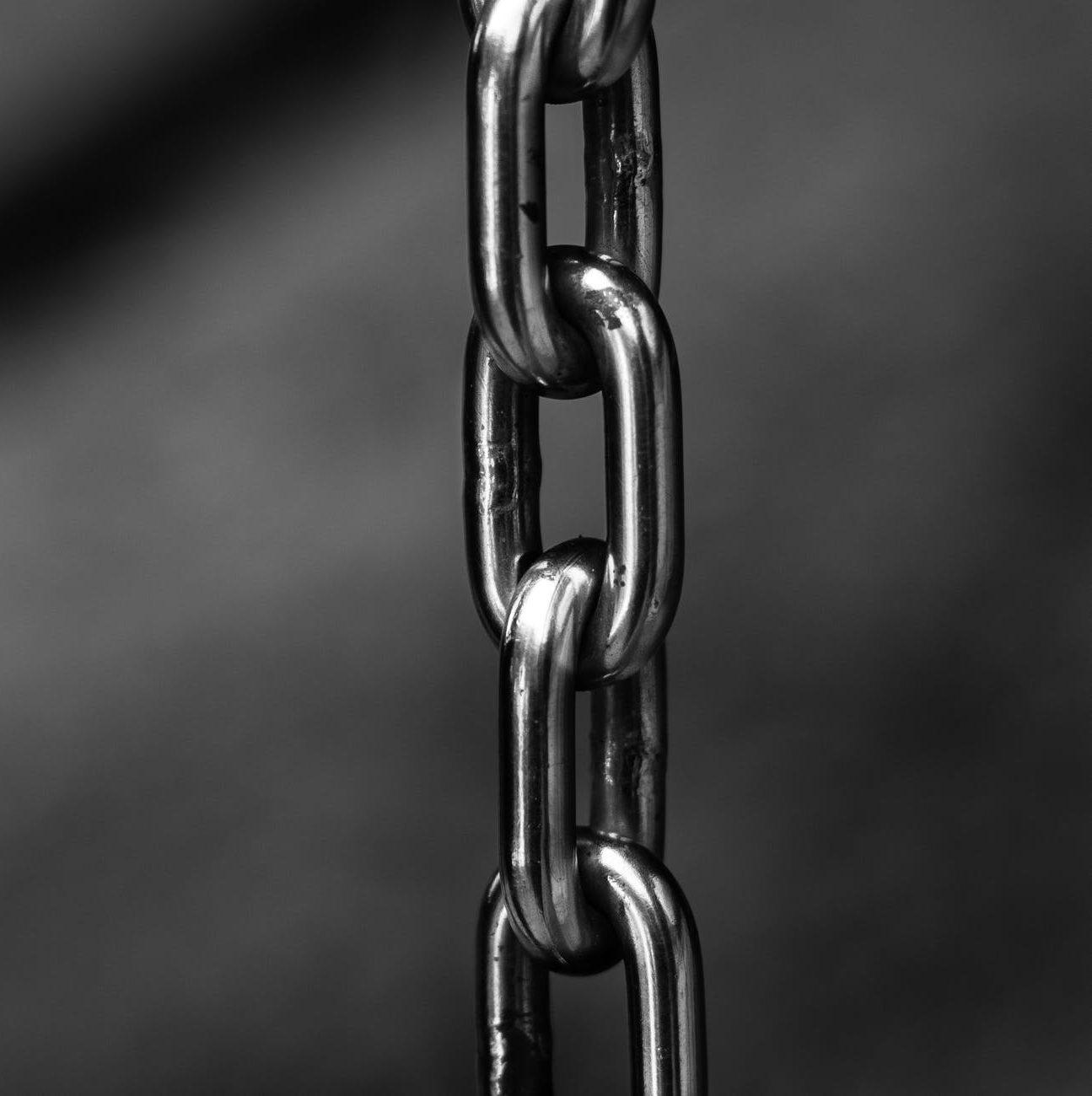 blur chains chrome close up