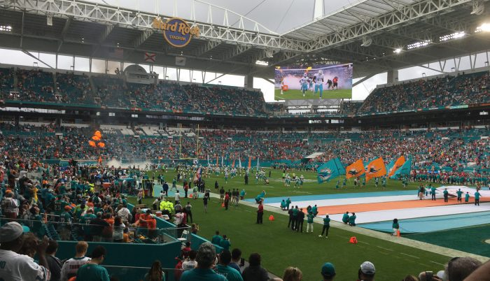 Miami Dolphins fans players flags display at Hard Rock Stadium