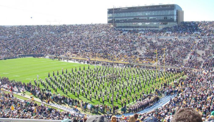 Notre Dame Fighting Irish marching band performance at football field
