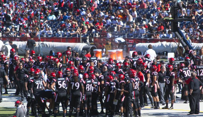 San Diego State Aztecs football players on field