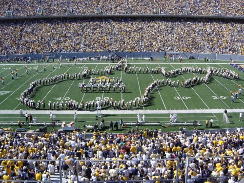pregame performance Mountaineer Marching Band forming the state of WV outline