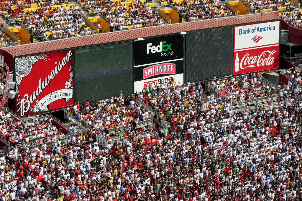 Washington Redskins fans at the game score board at Fedex field