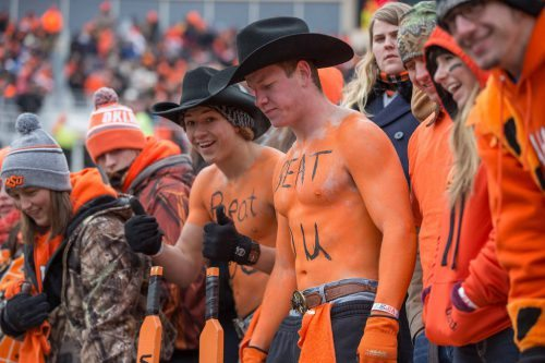 Oklahoma State Cowboys paddle people