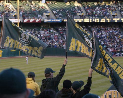 Oakland Athletics fans waving flags at the game