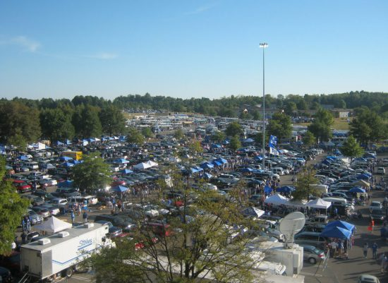 Akron Zips fans tailgating at parking lot on football gameday