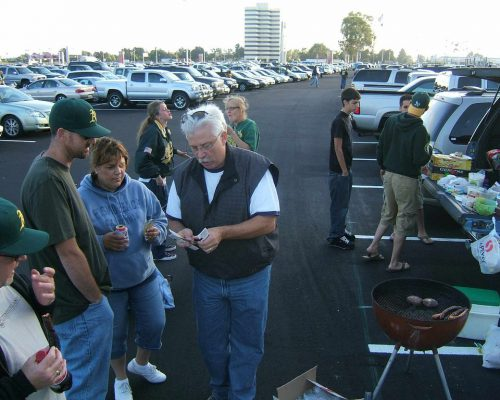 Oakland Athletics fans tailgate at parking lot barbecue