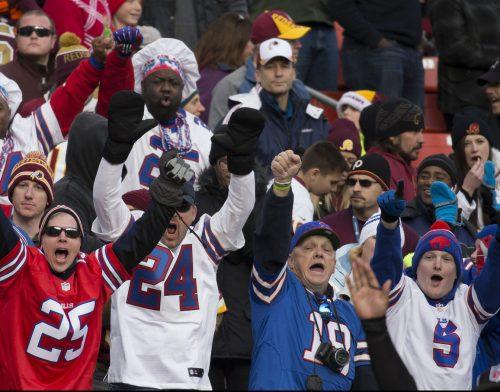 Buffalo Bills fans cheering at a football game