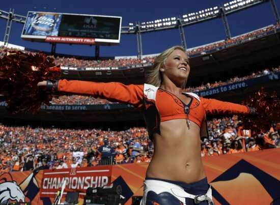 Denver Broncos cheerleader and fans at Empower Field at Mile High