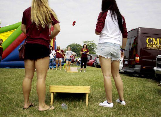 CMU Chippewas football fans at tailgate lot playing cornhole