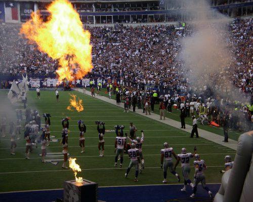 Dallas Cowboys players and cheerleaders at AT&T Stadium
