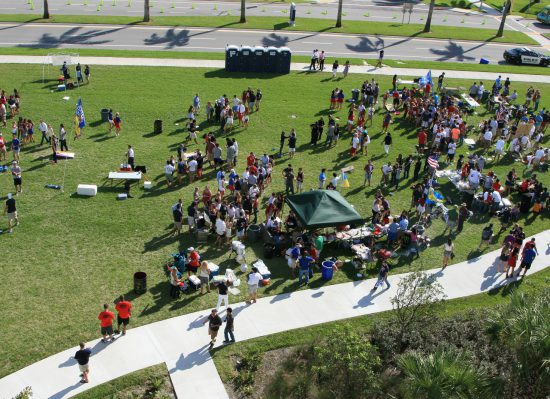 FAU Owls fans tailgating at tailgate lot on football gameday