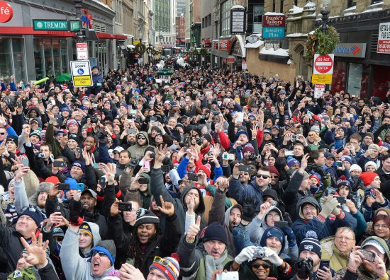 a crowd of New England Patriots Pats fans in the streets
