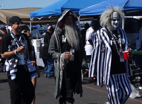 fans dressed in costume at Oakland Raiders game