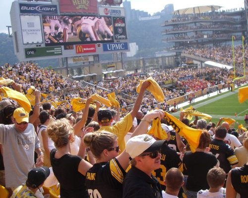 Pittsburgh Steelers fans doing the terrible towel tradition at Heinz Field