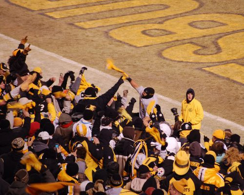 fans cheering at the Pittsburgh Steelers game terrible towel tradition