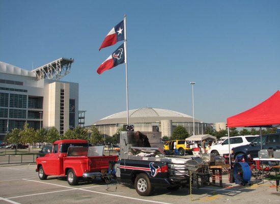 Houston Texans fans tailgate at parking lot