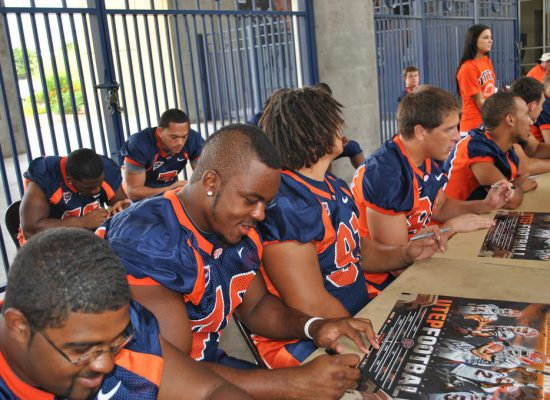 UTEP Miners football players signing autographs