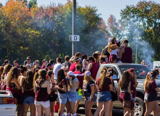 UMass Minutemen fans tailgating at tailgate lot on football gameday