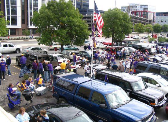 Minnesota Vikings fans tailgating at parking lot US flag