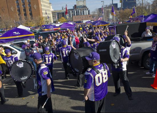 fans tailgating in parking lot at Minnesota Vikings game band performance